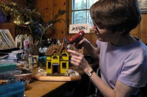 Marilyn Cosho making miniatures